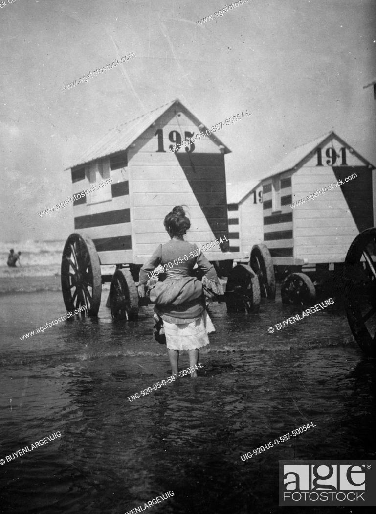Stock Photo: Bathing Booths at Ostend, Belgium, womanbather lifts up her dress 1912.