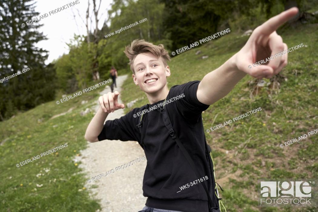 Stock Photo: Young boy in countryside, pointing with his finger. Bad Tölz, Upper bavaria, Germany.