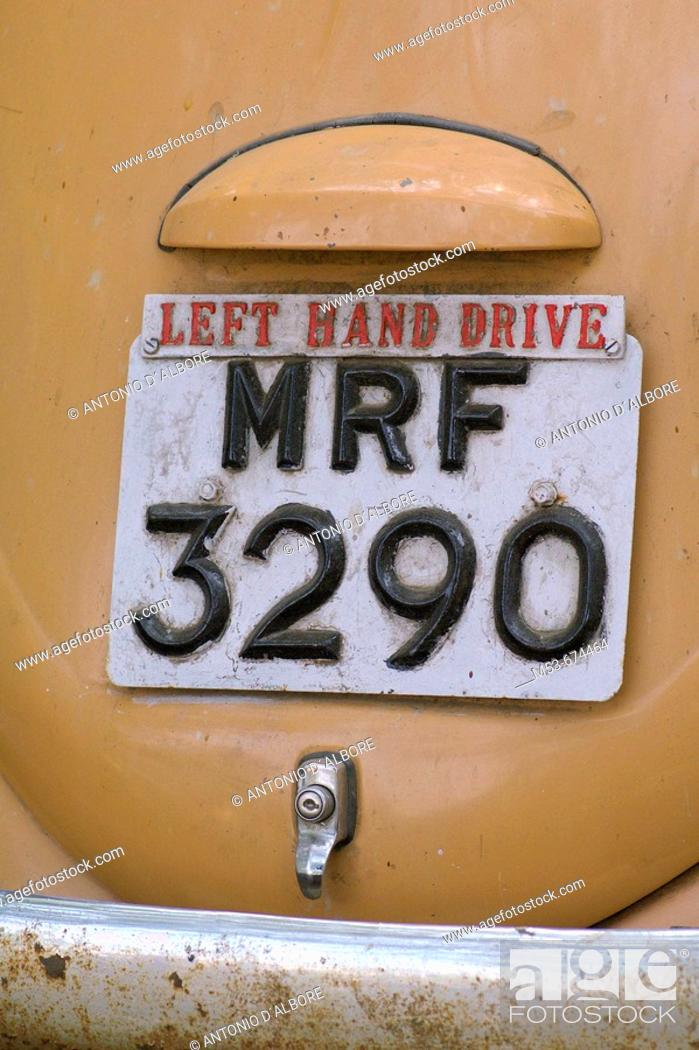 Stock Photo: Plate with additional 'left hand drive' sign on an abandoned car in Santacruz district, Mumbai, Maharashtra, India.