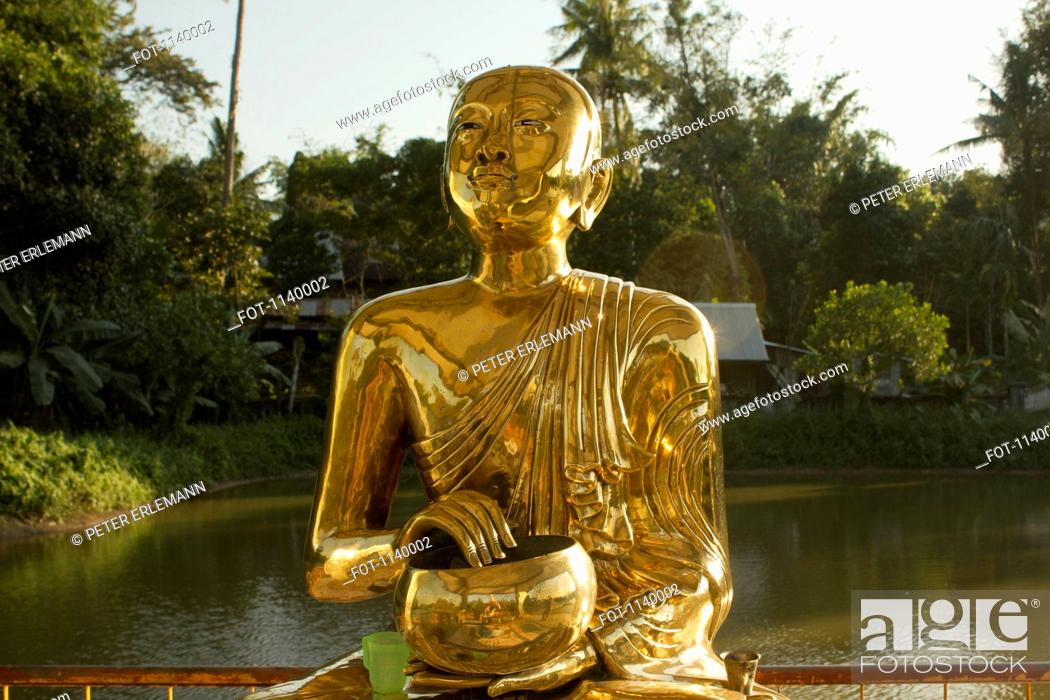 Stock Photo: A gold Buddhist statue, Yangon, Burma.