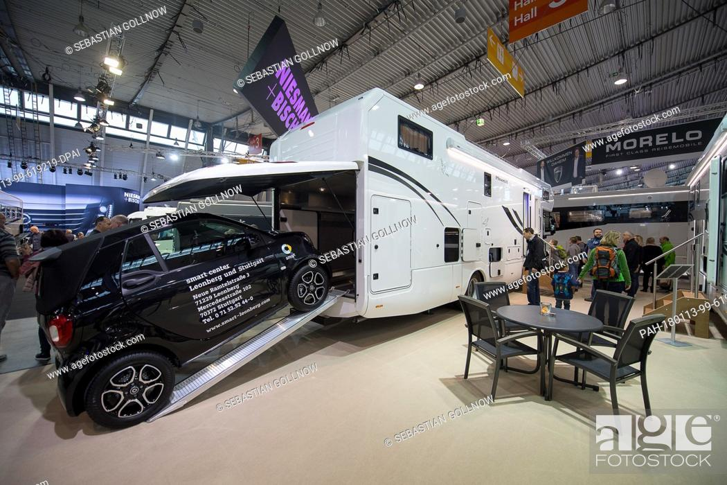 A Smart Is Parked On The Garage Of Phoenix Brand Luxury Caravan At