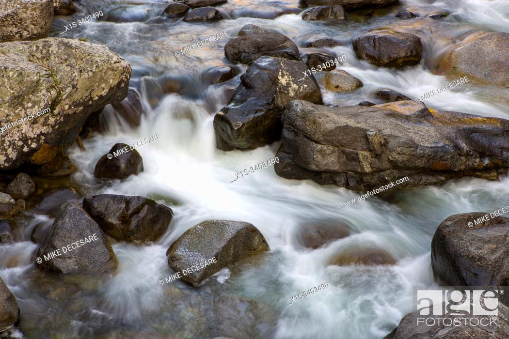 Stock Photo: Boulders strewn across the creek bed create small waterfalls within Icicle Creek in The Alpine Lakes Wilderness area in North Central Washington.