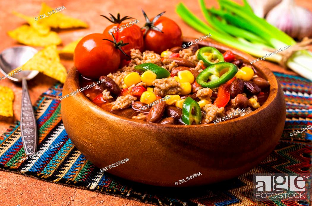 Traditional Mexican Chili Con Carne On The Table With Vegetables And Nachos Stock Photo Picture And Low Budget Royalty Free Image Pic Esy 042274298 Agefotostock