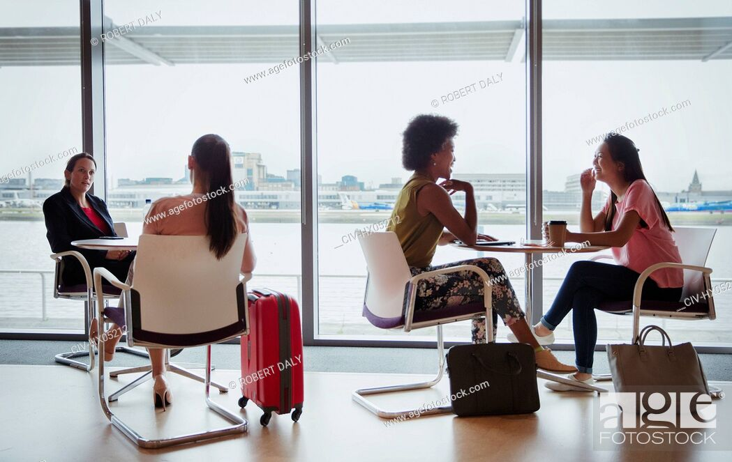 Stock Photo: Businesswomen talking in airport business lounge.