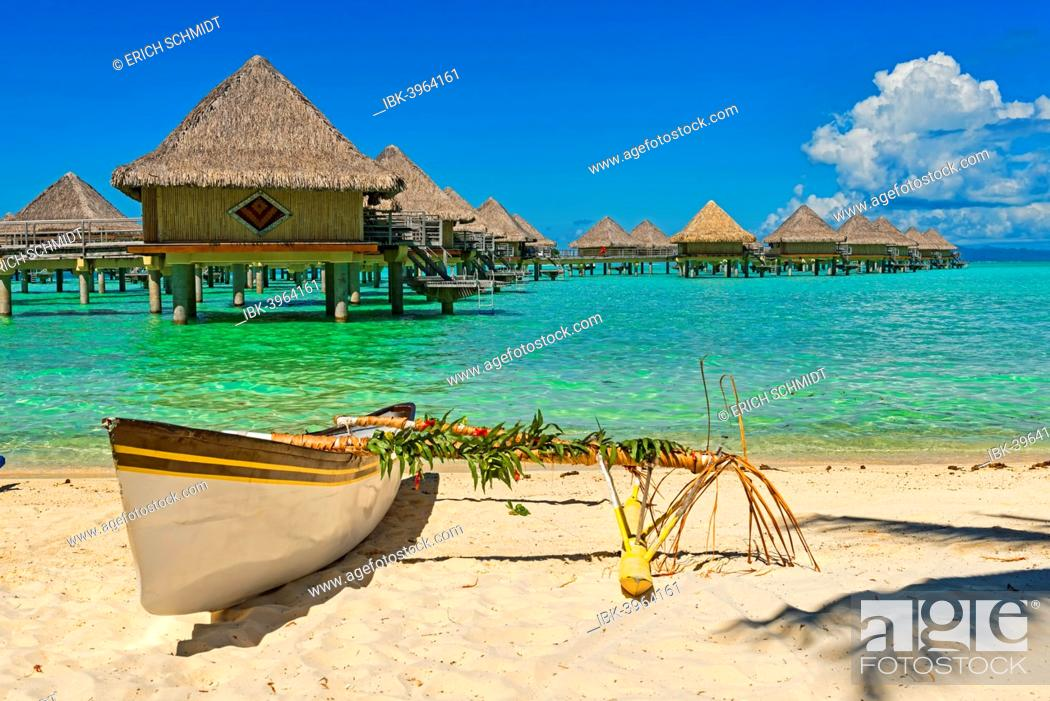 Stock Photo: Polynesian outrigger canoe in front of pile bungalow complex, South Pacific, Bora Bora, French Polynesia.