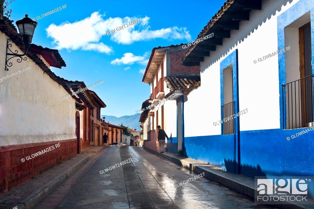 Stock Photo: Houses along a street, San Cristobal De Las Casas, Chiapas, Mexico.