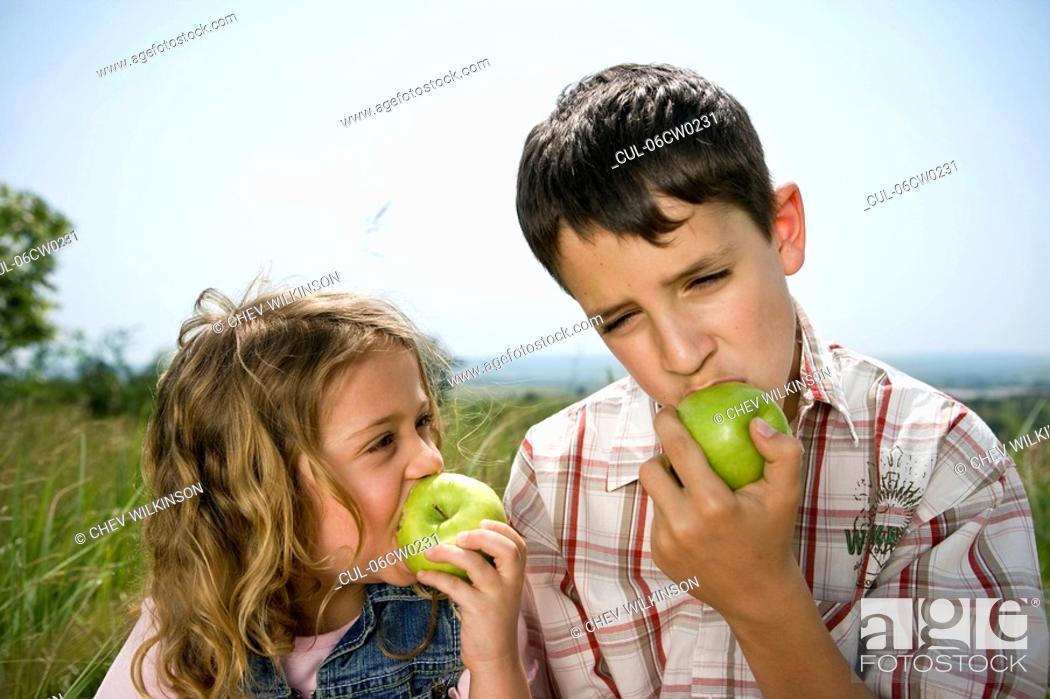 Stock Photo: Children eating apples.