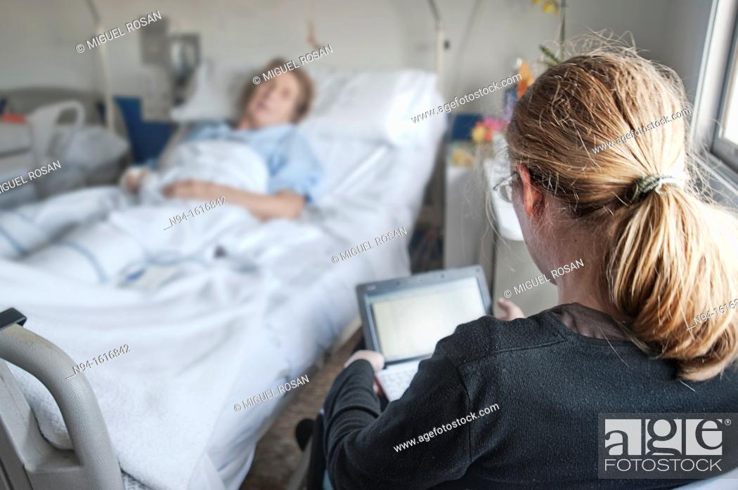 Stock Photo: Companion for a sick family, in the hospital.