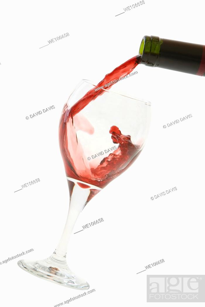 Stock Photo: Red Wine pouring into glass.