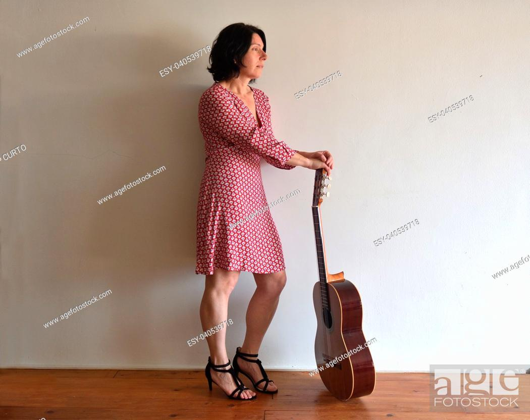 Stock Photo: portrait of a woman with a guitar.