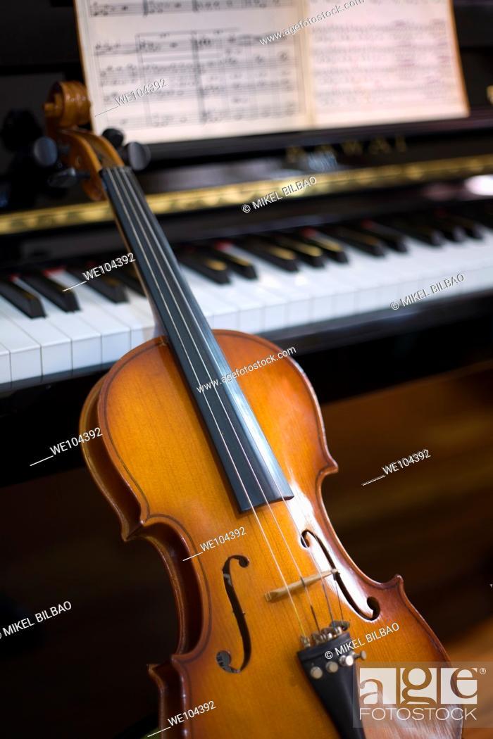 Stock Photo: piano, violin and score.
