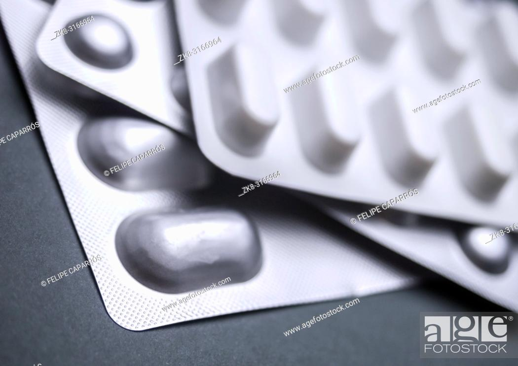 Stock Photo: Many Medicines Pills Capsules Of Diferent Size, conceptual image.
