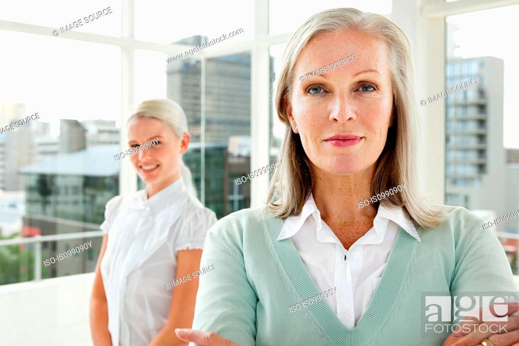 Stock Photo: Two businesswomen in office, portrait.