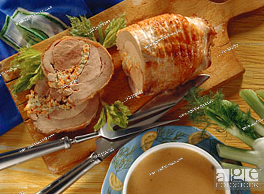 Stock Photo: Turkey roll with vegetable stuffing on chopping board.