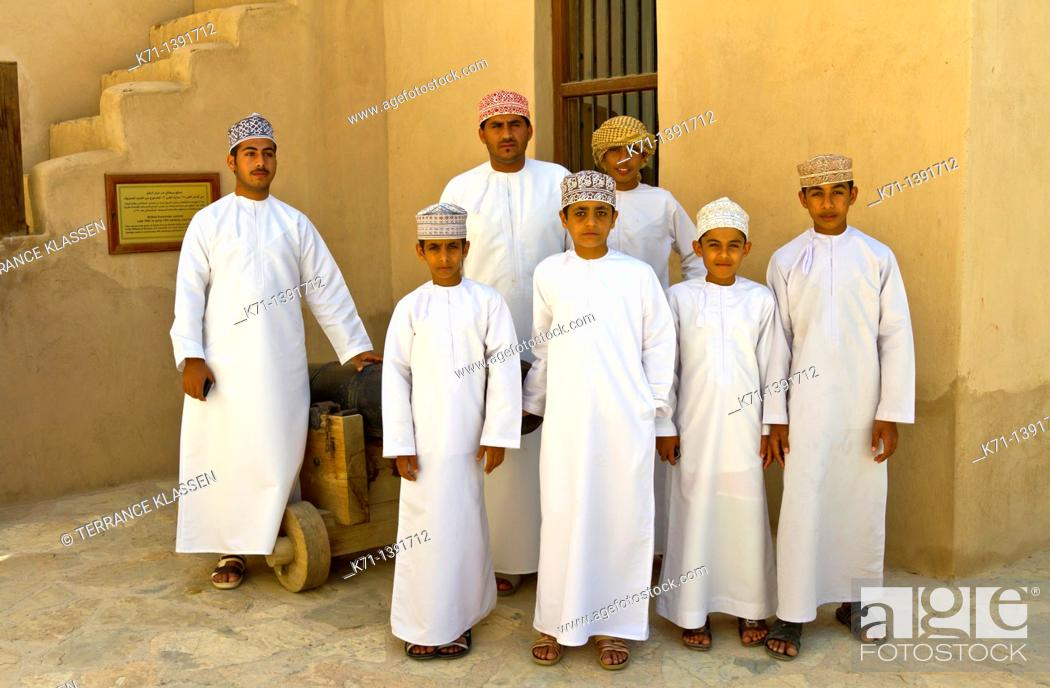 Stock Photo: Omanian students at the Nizwa fort, Sultanate of Oman.