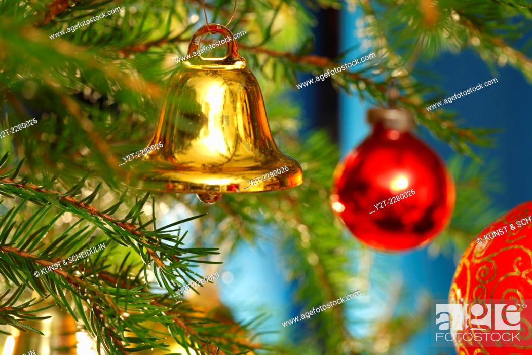 Photo de stock: A golden bell is hanging on the Christmas tree.