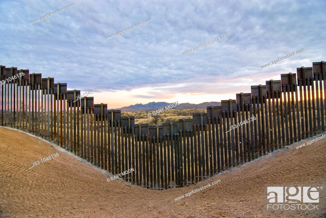 Stock Photo: United States border fence, US/Mexico border, east of Nogales, Arizona, USA, looking south from US side of border.