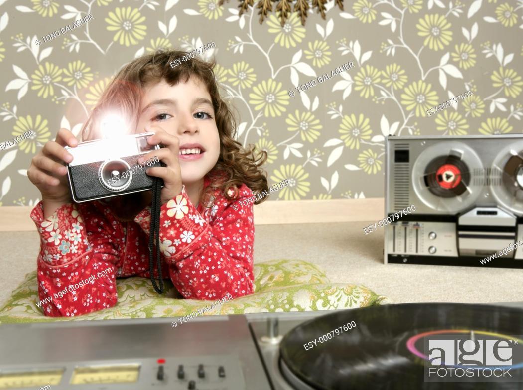 Stock Photo: camera retro photo little girl in vintage room wallpaper.