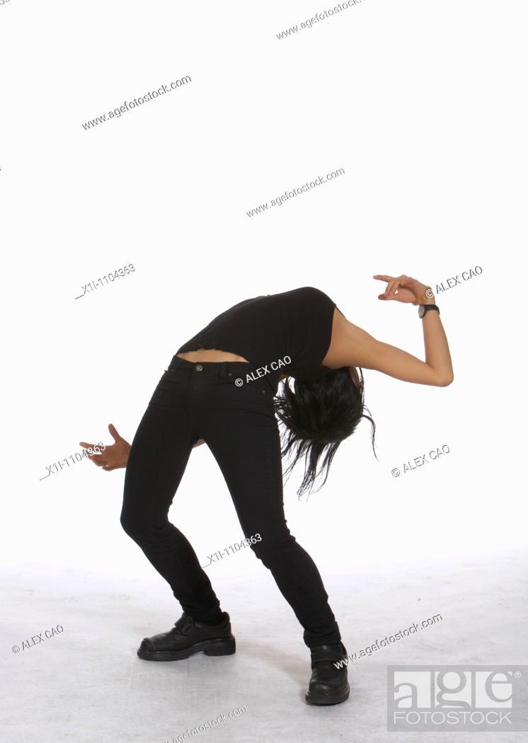 Stock Photo: Young woman bending backwards.