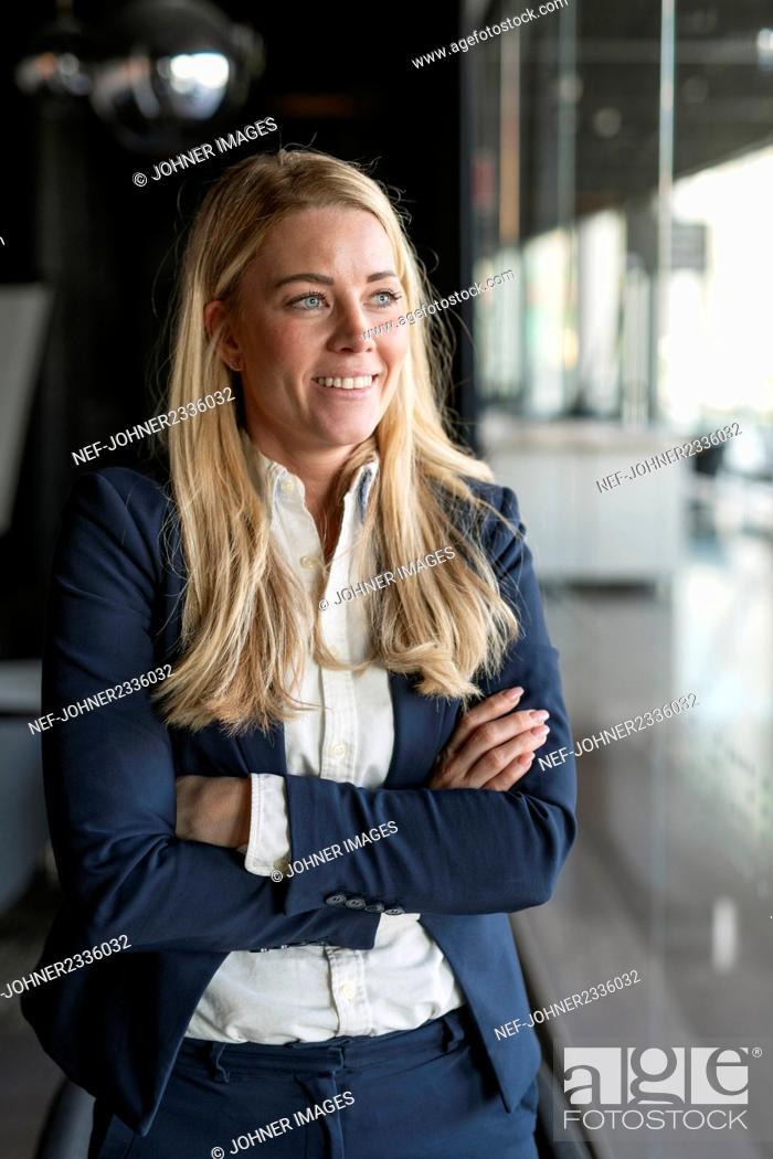Stock Photo: Businesswoman looking away.