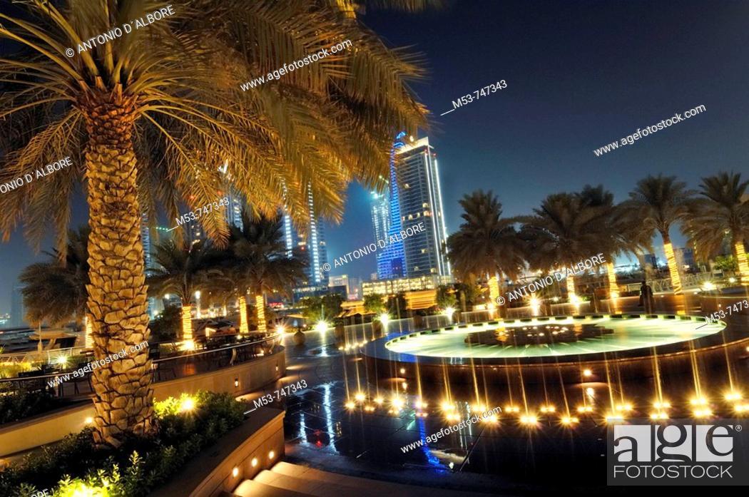 Stock Photo: Fountain during the night at Marina walk promenade, Marina district, Dubai, UAE.