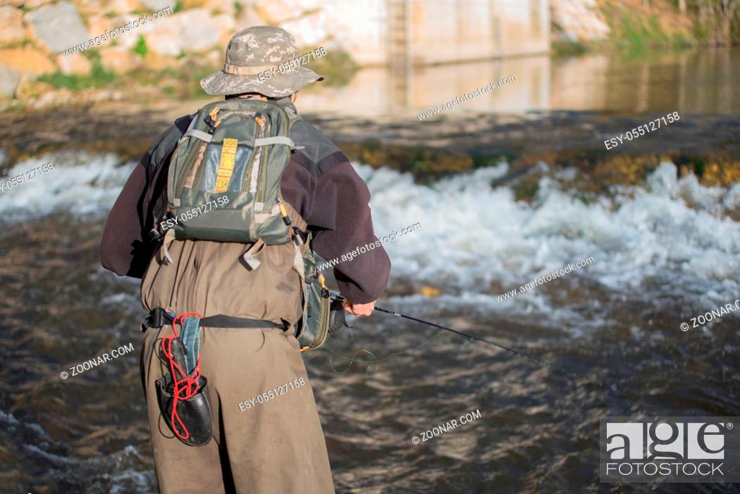 Stock Photo: Young man flyfishing on the river.