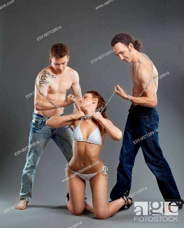 Stock Photo: Two man take woman on chain - bdsm games.