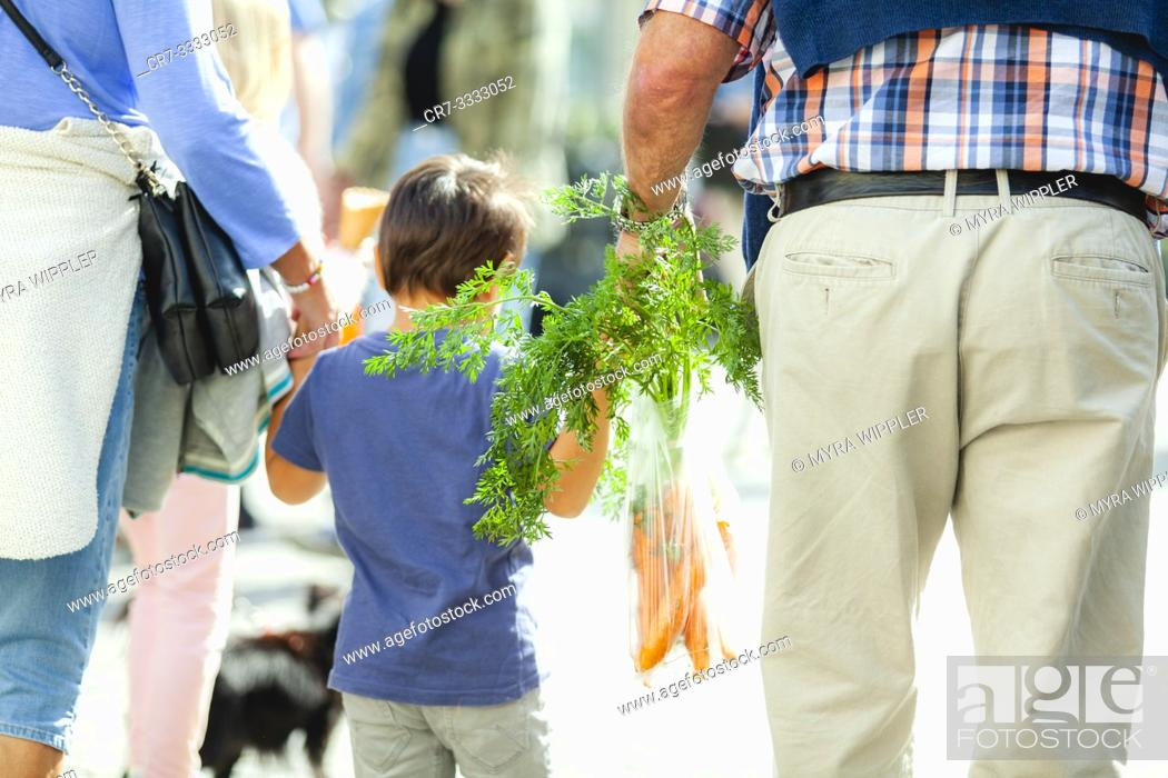 Stock Photo: Grandson and grandfather strolling at a market fair in Linköping, Sweden.