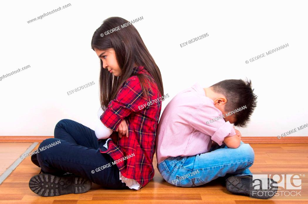 Stock Photo: upset brother and sister together.