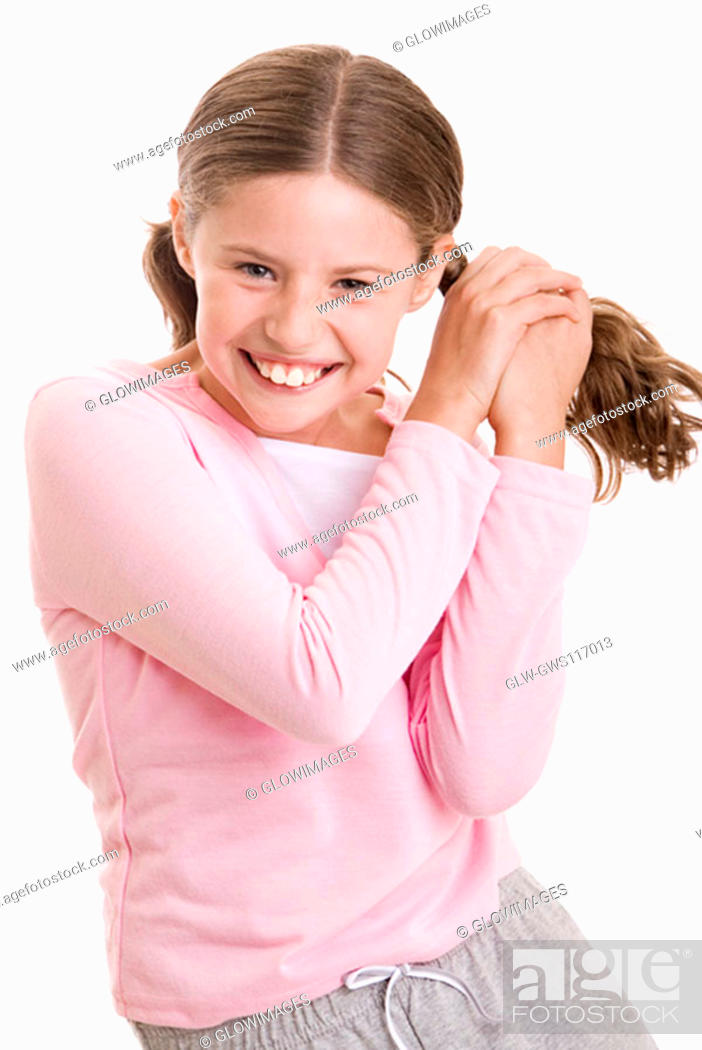 Stock Photo: Portrait of a girl holding her pigtail.