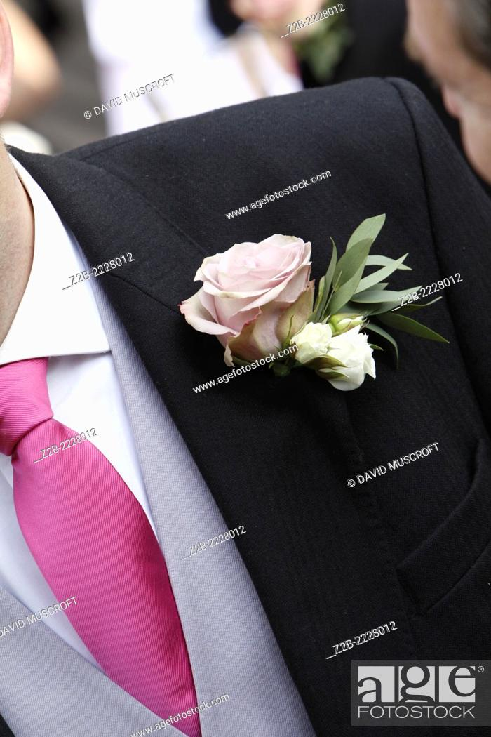 Stock Photo: Male wedding guest close up of button hole flower.