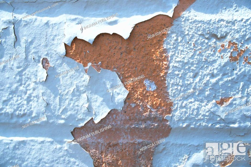 Stock Photo: Close-up of paint peeling off a wall.