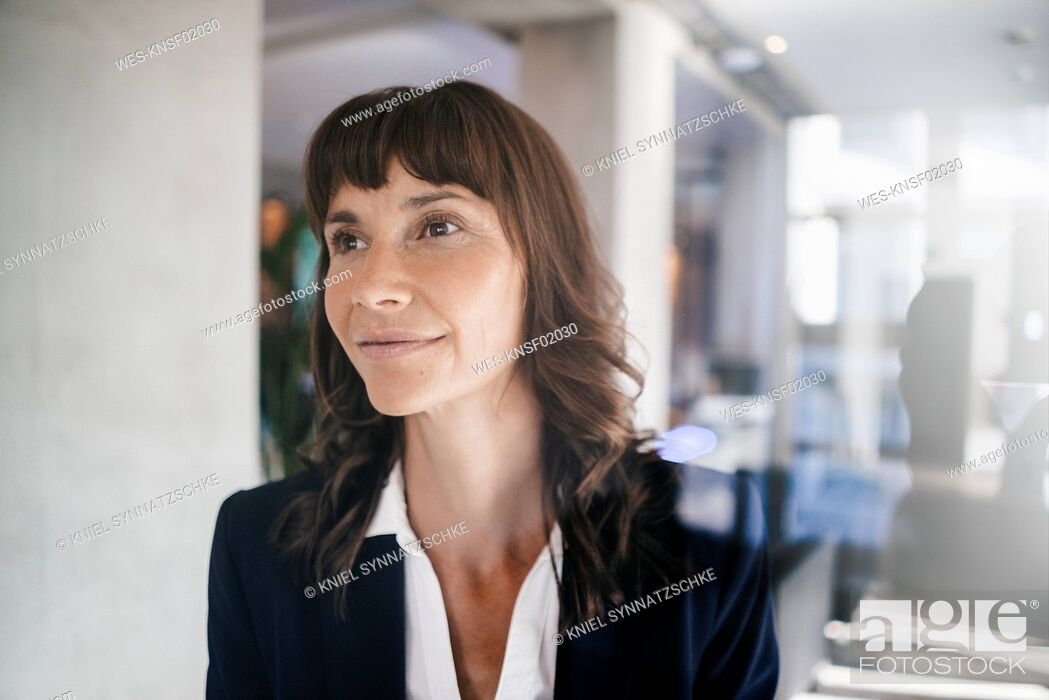 Stock Photo: Portrait of a pensive businesswoman.