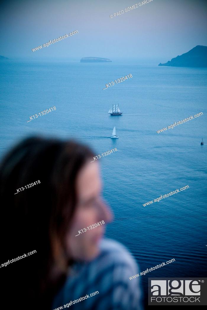 Stock Photo: Woman and sailboat in Oia  Santorini  Cyclades Islands  Greece.