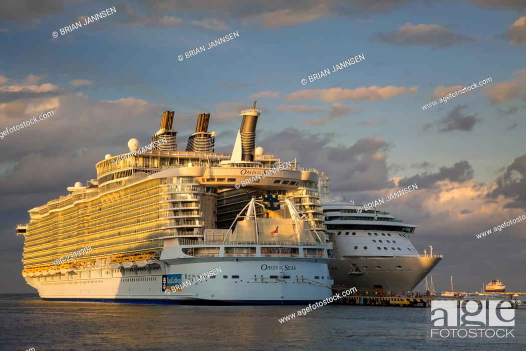 Stock Photo: Royal Caribbean's gigantic Oasis of the Seas Cruise ship dwarfs a more 'normal' sized ship in port, Cozumel, Yucatan, Mexico.