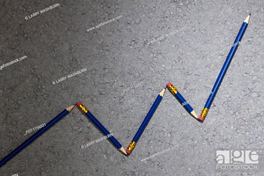 Stock Photo: Pencils arranged to depict an ascending line graph.