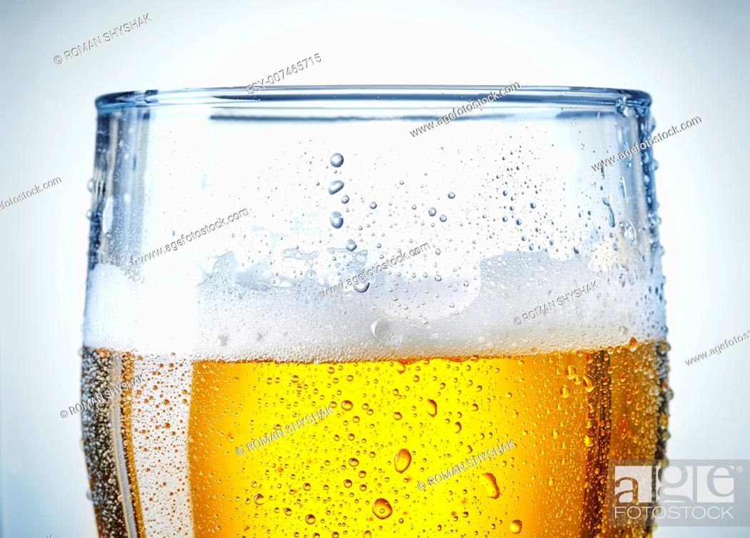 Stock Photo: beer glass with a bit of condensation.