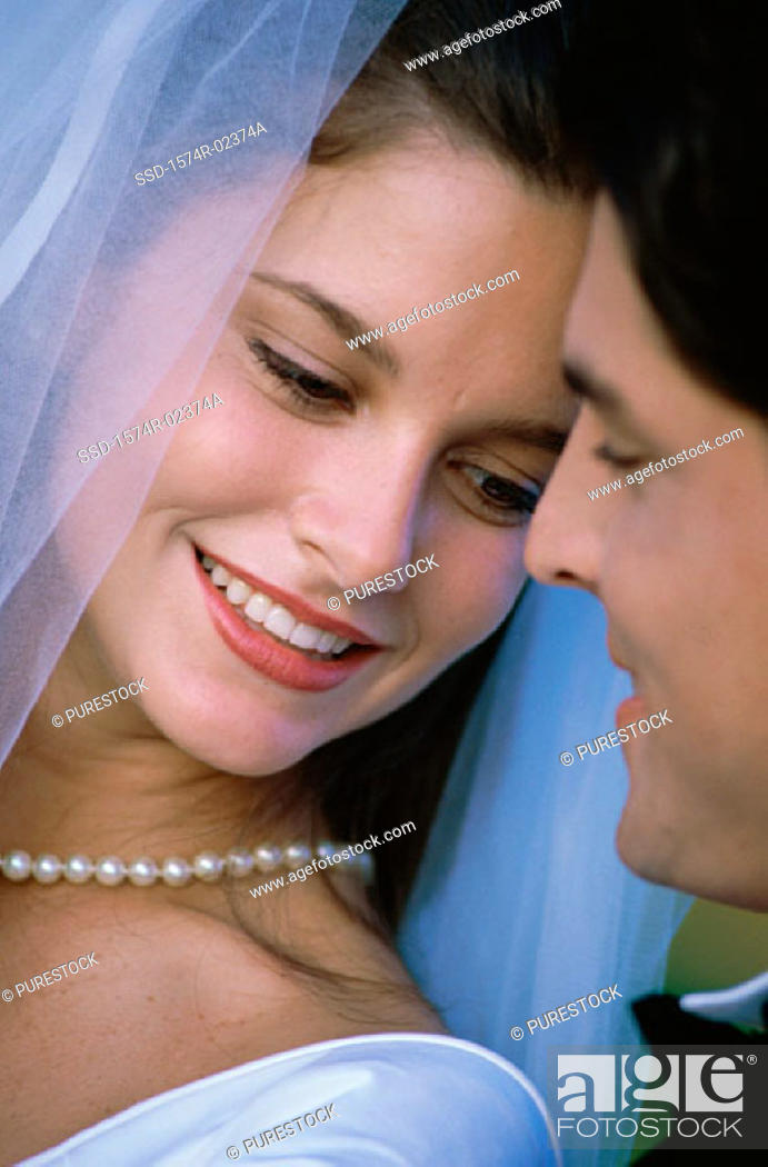 Stock Photo: Close-up of a newlywed couple smiling.