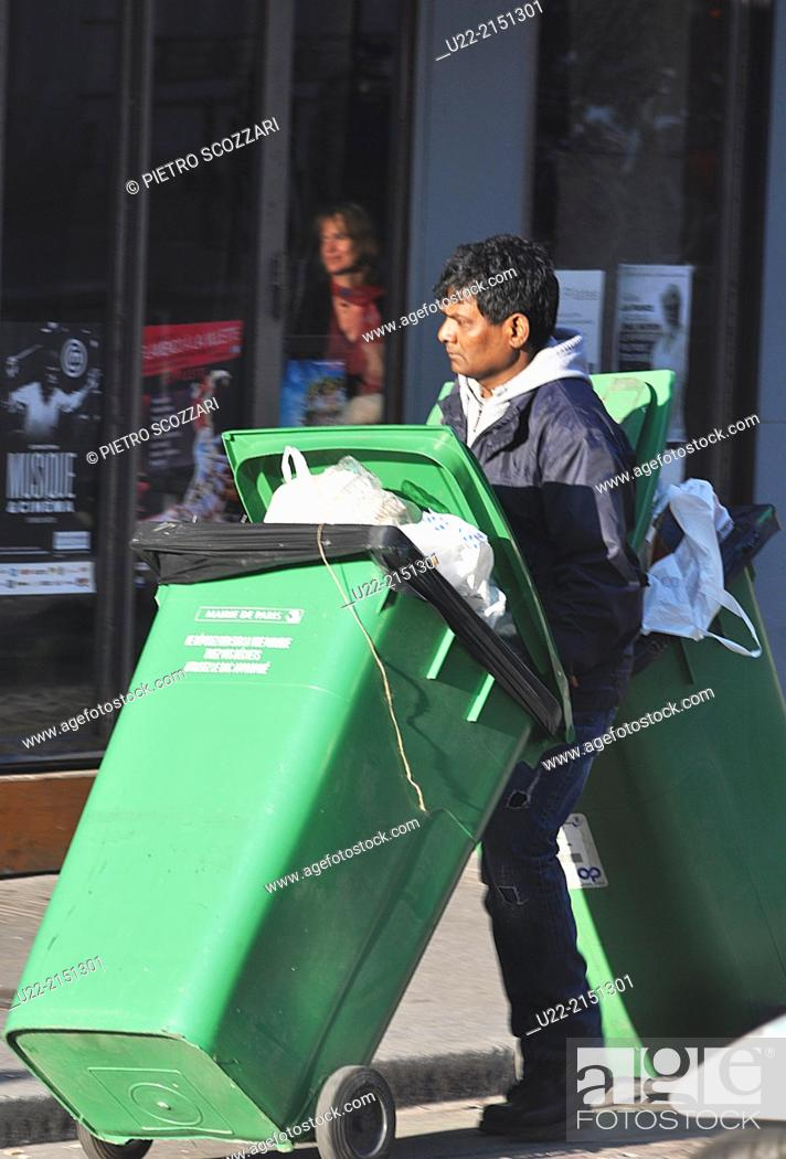 Stock Photo: Paris, France, an immigrant working as garbage collector.