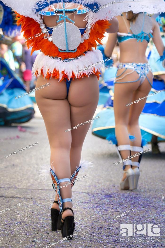 Photo de stock: Legs of a colorful Carnival (Carnaval) Parade festival female participant.