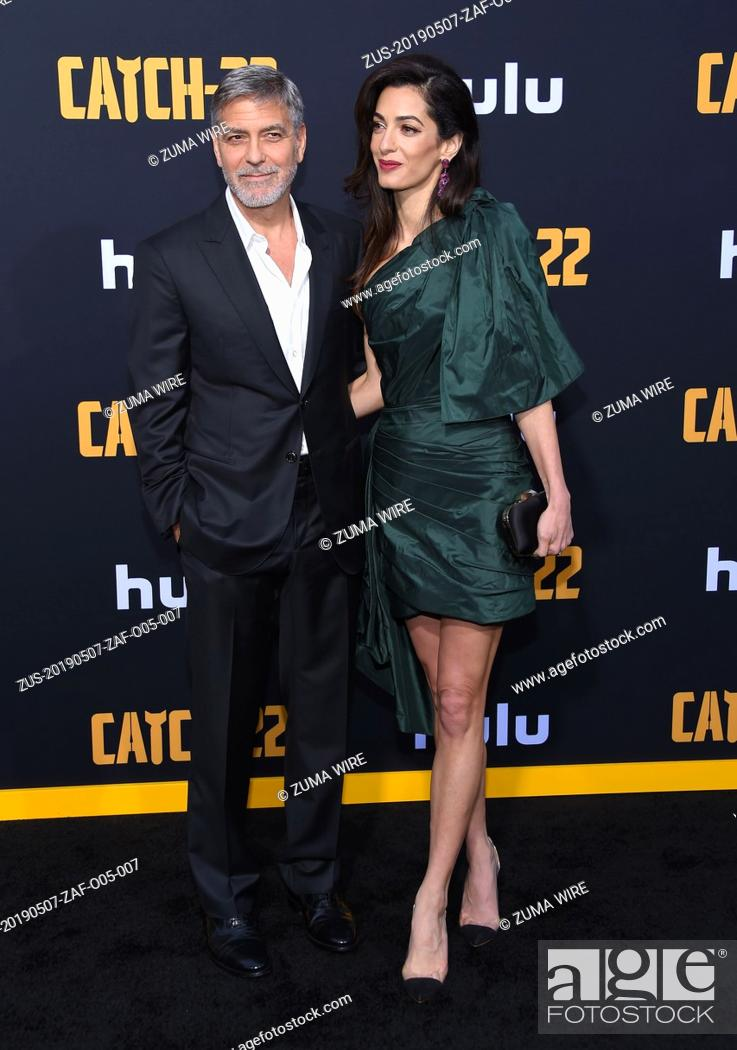 Stock Photo: May 7, 2019 - Hollywood, California, U.S. - George Clooney and Amal Clooney arrives forHulu's 'Catch-22' U.S. Premiere at the Chinese Theatre.