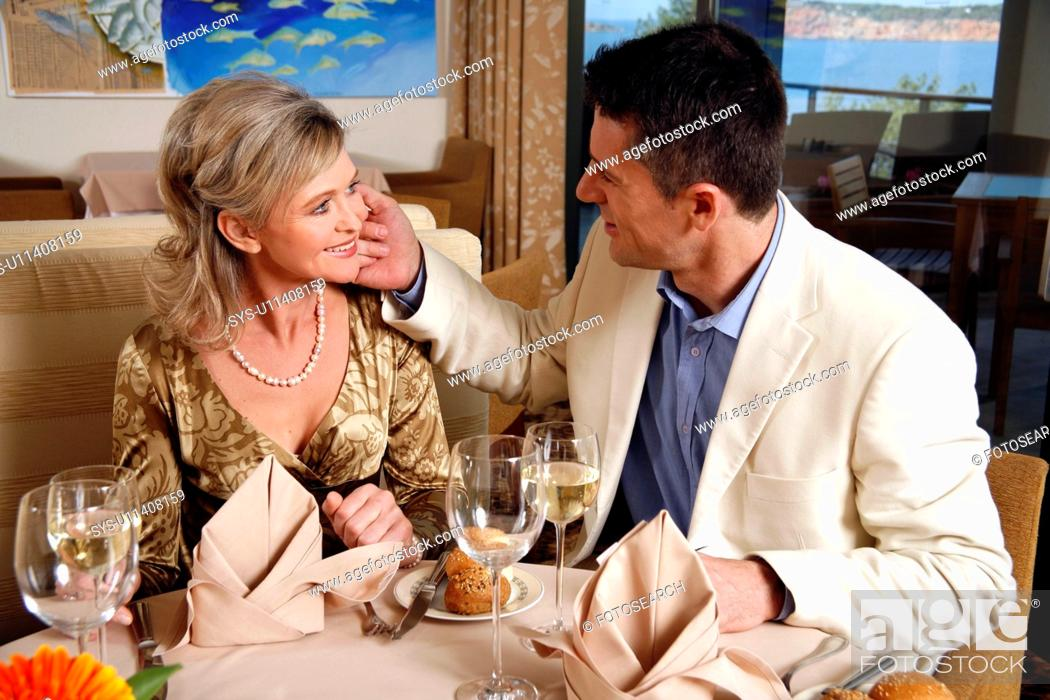 Stock Photo: Mature couple dining in a restaurant.