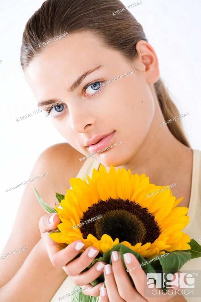 Stock Photo: woman with sunflower.