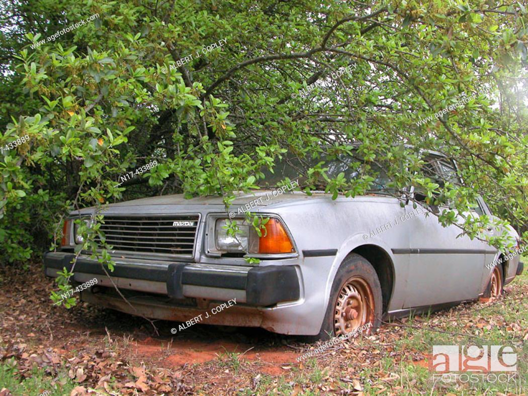 Stock Photo: Abandoned Mazda auto.