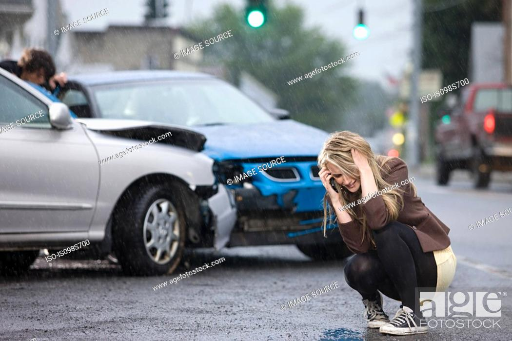 Stock Photo: Young woman involved in road accident.