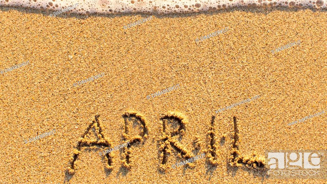 Stock Photo: Inscription APRIL on a gentle beach sand with the soft wave (months of the year series).