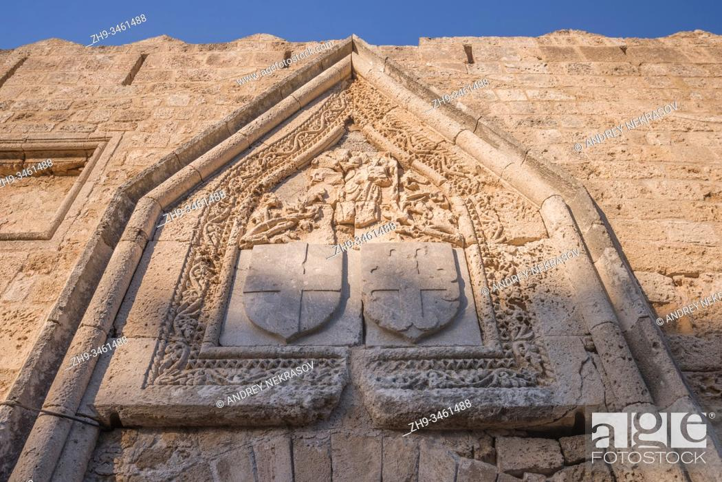Stock Photo: Coat of arms over the Gate of Saint John to the on medieval city inside of Fortifications of Rhodes. Greece.