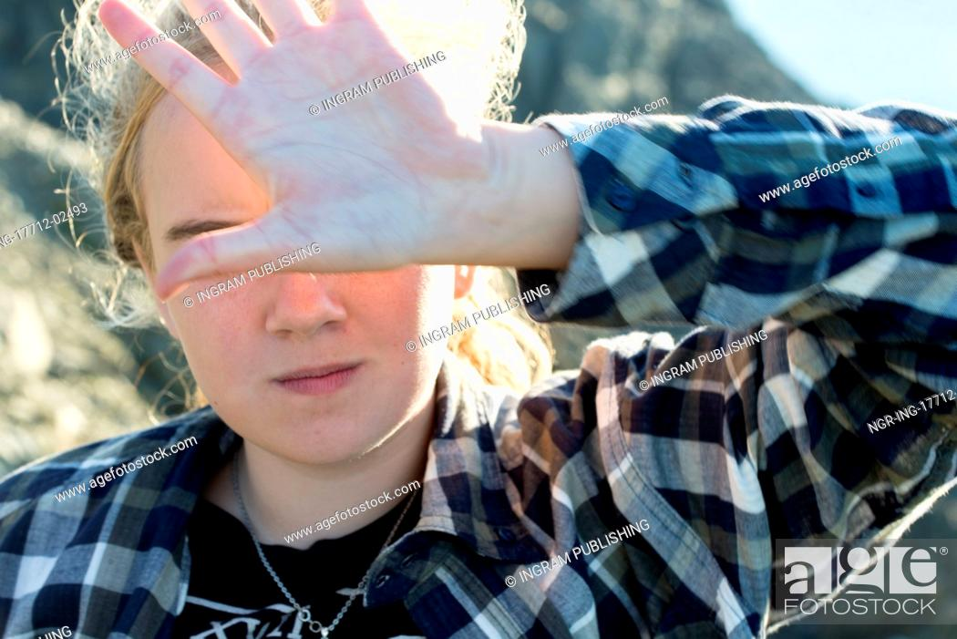Stock Photo: Girl covering face with hand, Long Point Hiking Trail, Crow Head, Twillingate, North Twillingate Island, Newfoundland And Labrador, Canada.