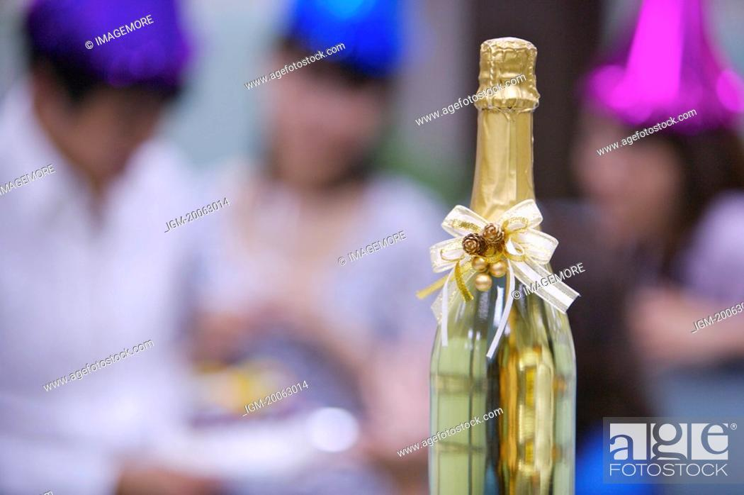 Stock Photo: Close-up of a bottle of champagne with bow.