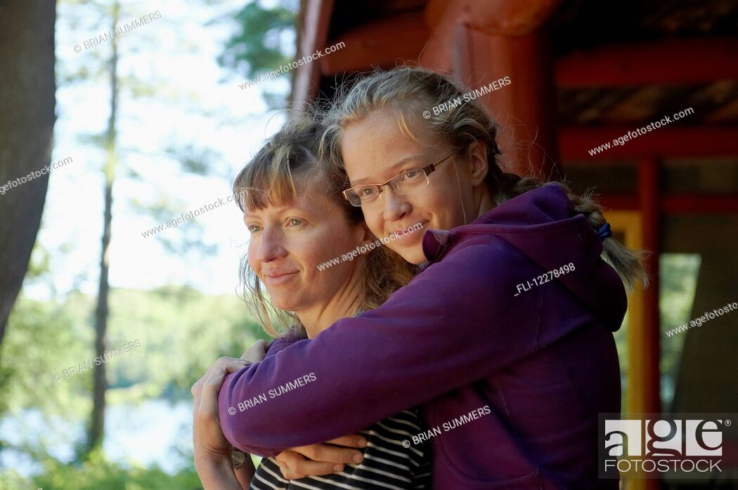 Stock Photo: Mother and daughter in an embrace; Lac des Neiges, Quebec, Canada.